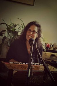 "Ellen ""Radha"" Katz at the harmonium during Bhakti Caravan rehearsal"